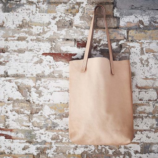 Sustainable leather shopping bag hanging on wall