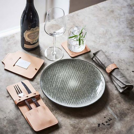 Dining table setup with sustainable leather items